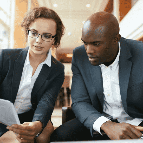 a gent and a lady reading a document
